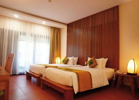 Hotelzimmer mit Mountainbike im Palm Garden Resort