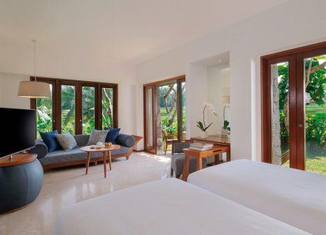 Hotelzimmer mit Mountainbike im Maya Ubud Resort & Spa
