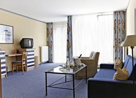 Hotelzimmer mit Mountainbike im Aparthotel Zingst