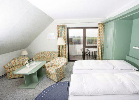 Hotelzimmer mit Volleyball im Nordseehotel Freese