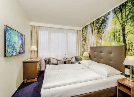 Hotelzimmer mit Mountainbike im AHORN Hotel Am Fichtelberg