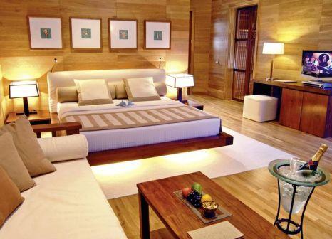 Hotelzimmer mit Tischtennis im Adaaran Prestige Water Villas