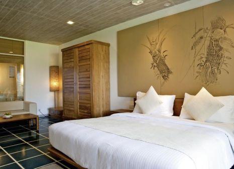 Hotelzimmer mit Mountainbike im Jetwing Blue