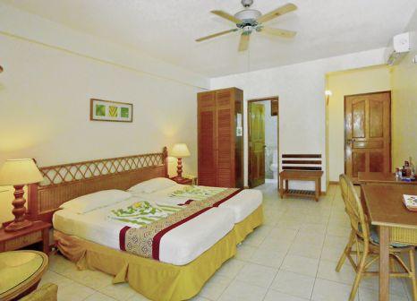 Hotelzimmer mit Tischtennis im Fihalhohi Island Resort