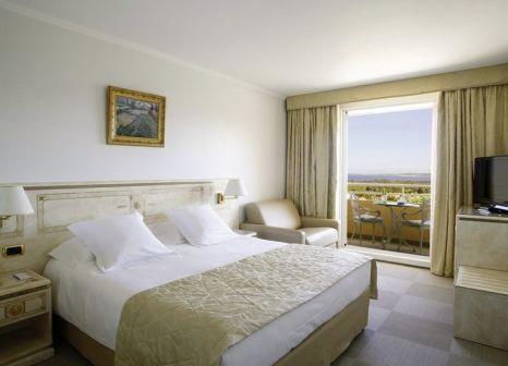 Hotelzimmer mit Golf im Hôtel Corsica