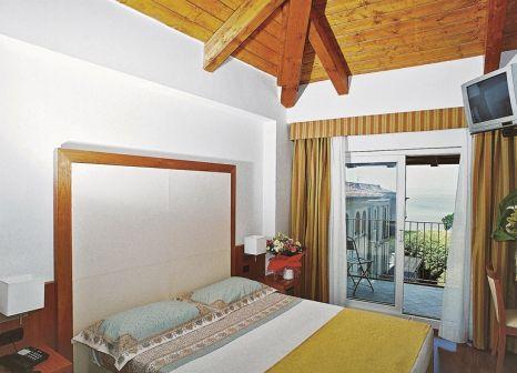 Hotelzimmer mit Mountainbike im Mavino