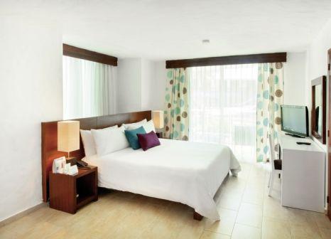 Hotelzimmer mit Volleyball im Select At Grand Paradise Playa Dorada