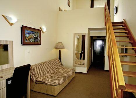 Hotelzimmer mit Mountainbike im Vile Oliva