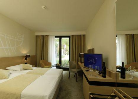 Hotelzimmer mit Minigolf im Hotel Liburna