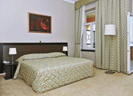 Hotelzimmer mit Mountainbike im Hotel Kvarner Palace