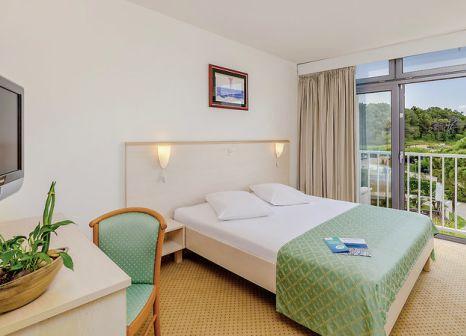Hotelzimmer mit Mountainbike im Rubin Sunny Hotel by Valamar