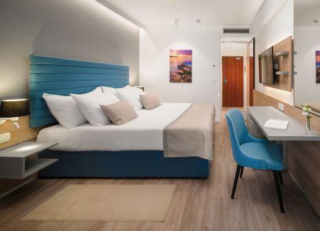 Hotelzimmer mit Mountainbike im Valamar Meteor Hotel