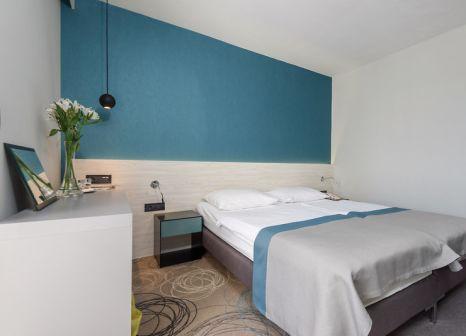 Hotelzimmer mit Minigolf im Hotel Kolovare