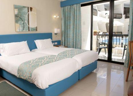 Hotelzimmer mit Mountainbike im Pergola Hotel & Spa