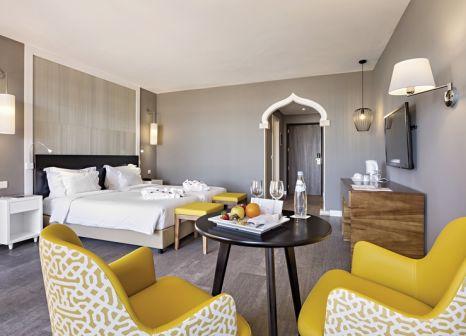 Hotelzimmer mit Mountainbike im Oriental Hotel