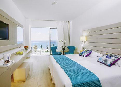 Hotelzimmer mit Tennis im King Evelthon Beach Hotel and Resort