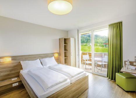 Hotelzimmer mit Tennis im COOEE alpin Hotel Kitzbüheler Alpen