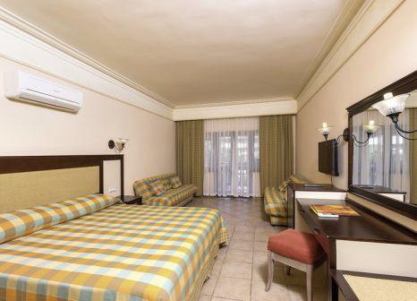 Hotelzimmer mit Mountainbike im Melas Holiday Village