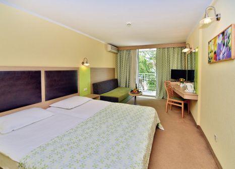 Hotelzimmer mit Mountainbike im Hotel Gergana