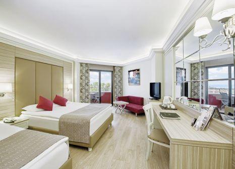 Hotelzimmer mit Mountainbike im Delphin Deluxe