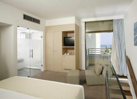 Hotelzimmer mit Mountainbike im Capo Bay Hotel