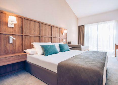Hotelzimmer mit Mountainbike im Iberostar Cala Domingos