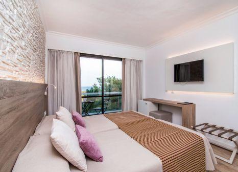 Hotelzimmer mit Mountainbike im Hotel Na Taconera