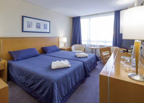 Hotelzimmer mit Mountainbike im Vila Nova Hotel
