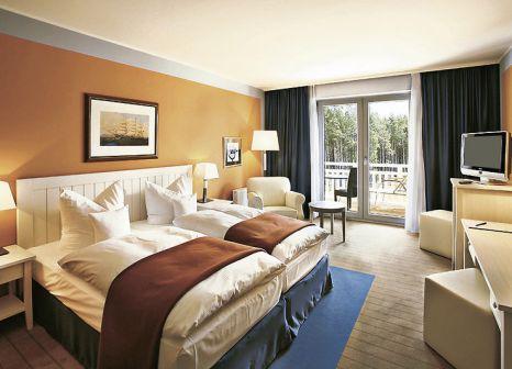 Hotelzimmer mit Mountainbike im Precise Resort Hafendorf Rheinsberg