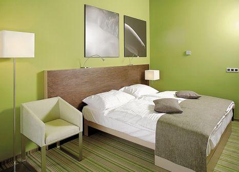 Hotelzimmer mit Mountainbike im Terme Olimia Sotelia