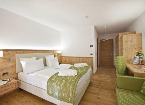 Hotelzimmer mit Mountainbike im Rio Stava Family Resort & Spa