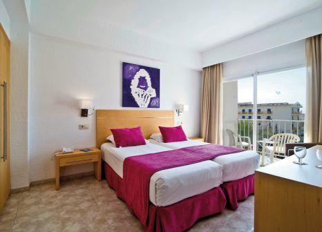 Hotelzimmer mit Mountainbike im Capricho