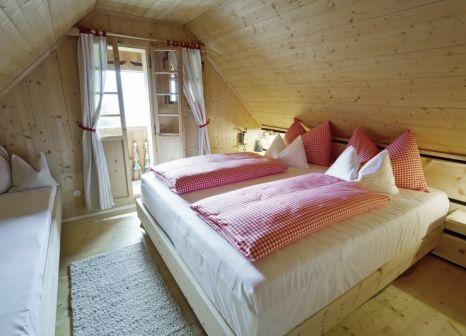 Hotelzimmer mit Paddeln im Almdorf Seinerzeit