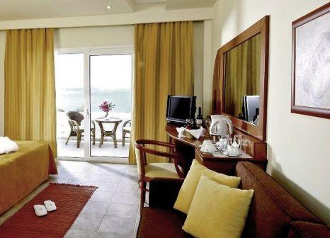 Hotelzimmer mit Mountainbike im Alexandros Palace Hotel & Suites