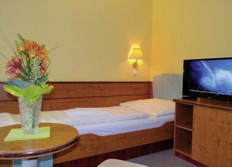Hotelzimmer mit Ski im Montana