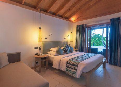 Hotelzimmer mit Mountainbike im Vilamendhoo Island Resort & Spa