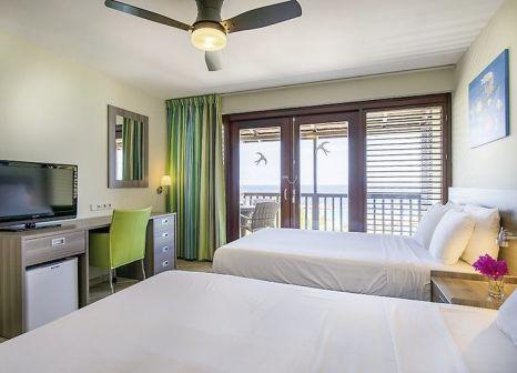 Hotelzimmer mit Mountainbike im LionsDive Beach Resort