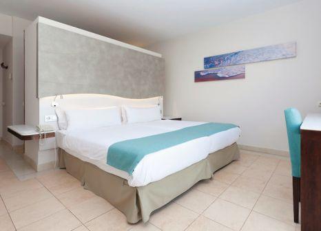 Hotelzimmer mit Mountainbike im Impressive Playa Granada