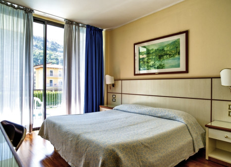 Hotelzimmer mit Mountainbike im Hotel Holiday