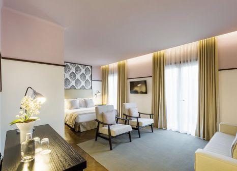Hotelzimmer mit Mountainbike im Castanheiro Boutique Hotel