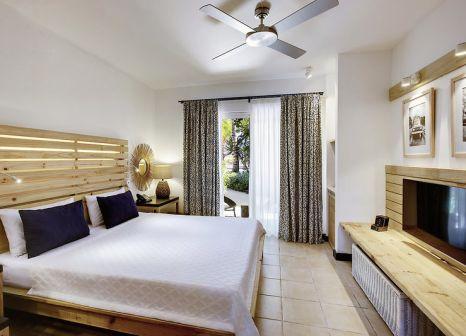 Hotelzimmer mit Mountainbike im Veranda Pointe aux Biches Hotel