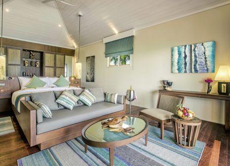 Hotelzimmer mit Mountainbike im Hurawalhi Island Resort