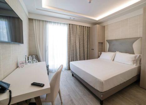 Hotelzimmer mit Mountainbike im Splendido Bay Luxury Resort