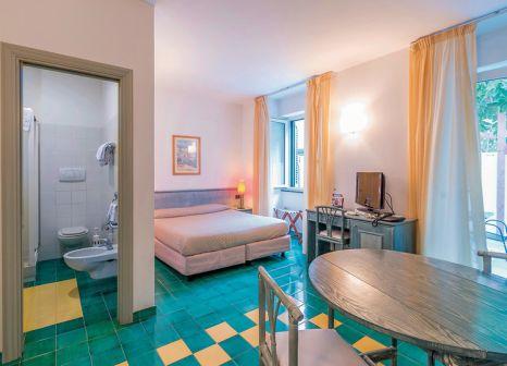 Hotelzimmer mit Tischtennis im Hotel & Resort Le Axidie
