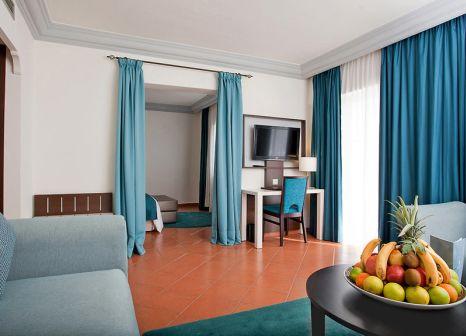 Hotelzimmer mit Mountainbike im Kenzi Europa Hotel