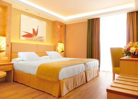 Hotelzimmer mit Mountainbike im Bull Hotel Costa Canaria & Spa