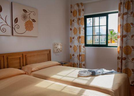 Hotelzimmer mit Mountainbike im GF Hotel Isabel