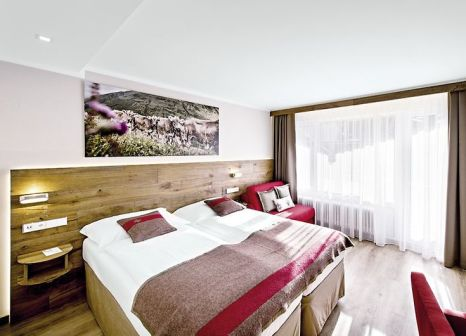 Hotelzimmer mit Mountainbike im Hotel Butterfly, BW Signature Collection