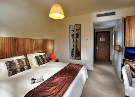 Hotelzimmer mit Mountainbike im Bibione Palace Suite Hotel