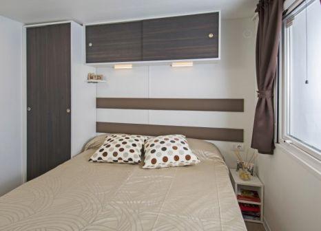 Hotelzimmer mit Mountainbike im FKK Valalta